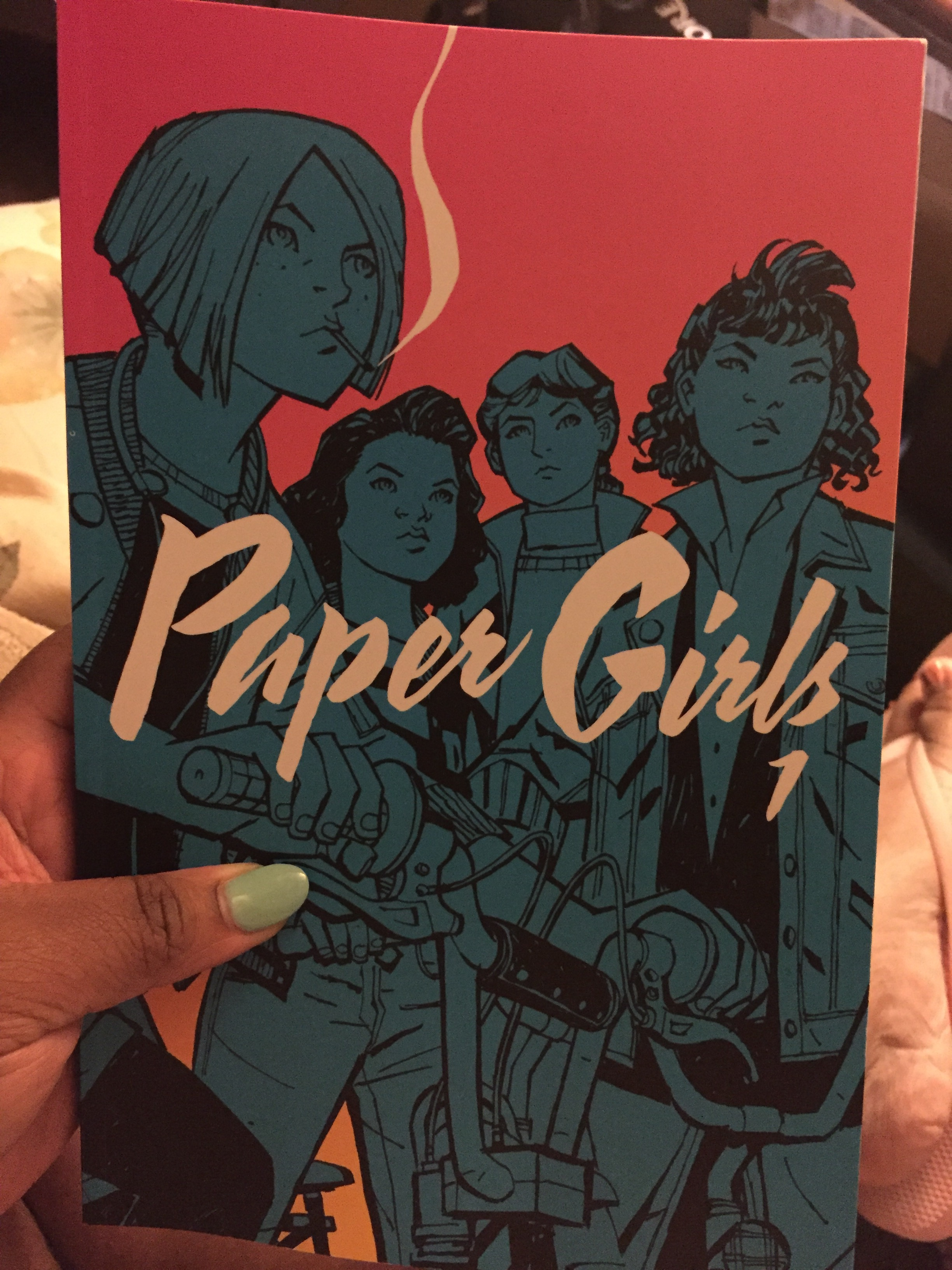 the cover of paper girls volume one